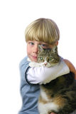 Boy with cat. Young boy with pet cat in arms royalty free stock photos