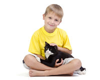 Boy with cat and brother Royalty Free Stock Image