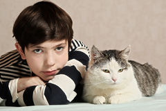 Boy with cat close up photo stock photography