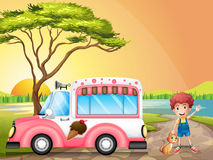 A boy with a cat beside an icecream truck Stock Photography