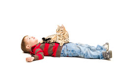 Boy and a cat lying on it Royalty Free Stock Image