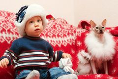 Boy with cat Santa Royalty Free Stock Photography