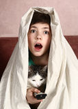 Boy with cat  watch horror movie Royalty Free Stock Images