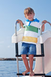 Boy on a catamaran Royalty Free Stock Image