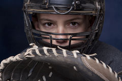 Boy in Catcher's Mask with Glove. Young teenage boy in catcher's mask with glove ready and dramatic dark blue background stock photography