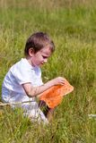 Boy catches a butterfly Stock Image
