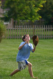 Boy Catching Ball Stock Photo