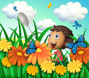 A boy catching butterflies at the flower garden stock illustration