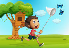 Boy catching butterflies in the garden. Illustration Royalty Free Stock Photo