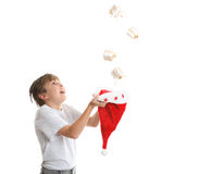 Boy catching Christmas present Stock Image