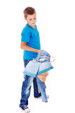Boy catching denim clothes Stock Image