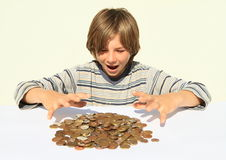 Boy catching money Stock Images