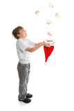 Boy catching presents Stock Photography
