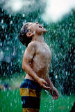 Boy Catching Rain In His Mouth Stock Photography
