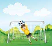 A boy catching the soccer ball Stock Photos
