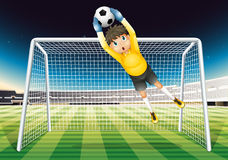 A boy catching the soccer ball Stock Images