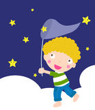 Boy catching star Royalty Free Stock Photos