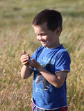 Boy with caterpillar Royalty Free Stock Photos