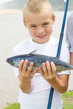 Boy caught fish Royalty Free Stock Photos