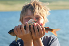 Boy caught grayling Stock Photo