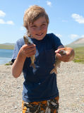 Boy caught grayling Stock Photos