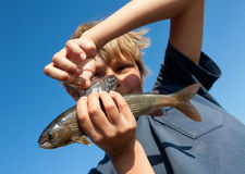 Boy caught grayling Royalty Free Stock Photo