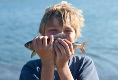Boy caught grayling Stock Photos