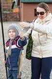 Boy caught trout, grandmother rejoices Stock Images