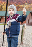 Boy caught trout Stock Images