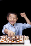 Boy celebrates chess win. Stock Images