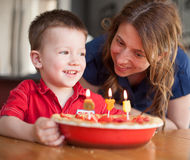 Boy celebrating his birthday with his mother Royalty Free Stock Photography