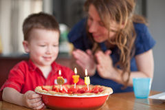 Boy celebrating his birthday with his mother Royalty Free Stock Image