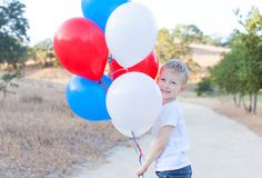 Boy celebrating 4th of July Stock Photos