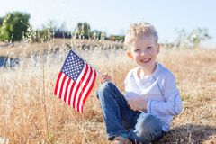 Boy celebrating 4th of July. Little boy holding american flag and celebrating 4th of July Royalty Free Stock Photo
