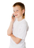 Boy on cell Royalty Free Stock Photos
