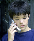 Boy and cell. Boy with attitude and cell phone stock photos