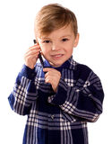 Boy and cell phone Royalty Free Stock Images