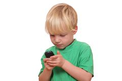 Boy with cell phone Royalty Free Stock Image