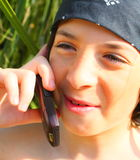 Boy on a Cell Phone Royalty Free Stock Photography
