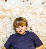 Boy in the  cellar with a spotlight Royalty Free Stock Photos
