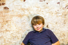 Boy in the  cellar with a spotlight Royalty Free Stock Photo