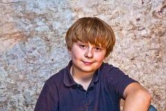 Boy in the  cellar with a spotlight Stock Photos