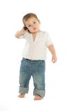 Boy with a cellphone. A little boy holding a cellphone near his ear Royalty Free Stock Image
