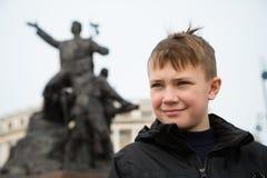 Boy in the center of Vladivostok in the spring stock image
