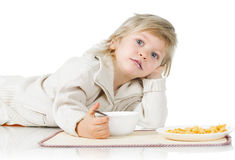 Boy and cereals Royalty Free Stock Photos