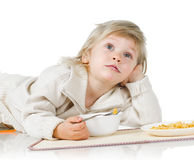Boy and cereals Stock Photos