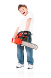 Boy with chainsaw Stock Images