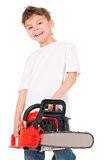 Boy with chainsaw Royalty Free Stock Photography