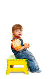 Boy on chair Stock Photography