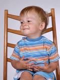 Boy on chair. Portrait of a little boy Royalty Free Stock Photos
